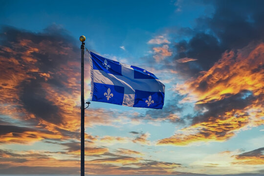 The Flag of Quebec flying against the sky