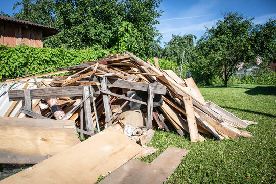Wooden debris at the yard, boards and plates. Construction and reconstruction