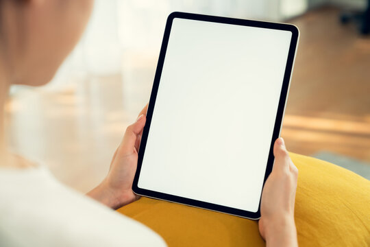 Hand holding digital tablet mockup of blank screen. Take your screen to put on advertising.