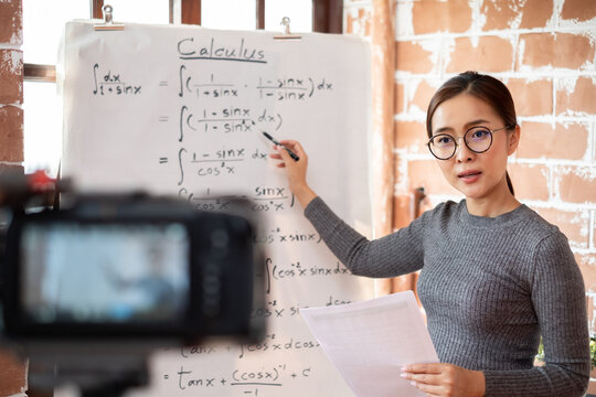 Asian woman teacher teaching lesson online learning via internet at home, self study and e-learning new normal concept