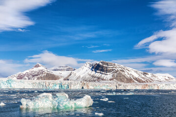Iceberg, glacier and the Three Crown mountains of Kongsfjorden, Svalbard