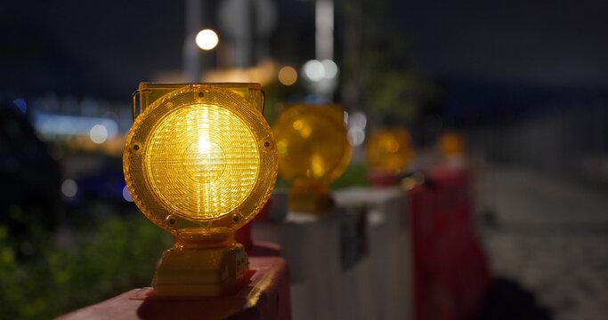 Yellow caution light at street