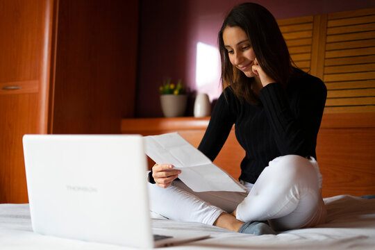 Woman doing her resume on the computer.