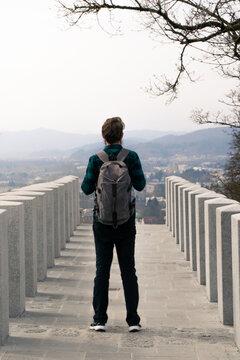 Image of man visiting a tourist attraction, Ljubljana, Slovenia.