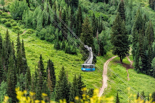 Alta, USA - July 27, 2019: Cable car gondola ride in mall ski resort town village by Albion Basin, Utah in summer and Cottonwood Canyon