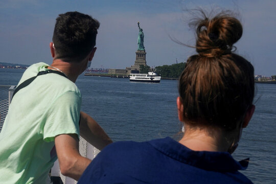 People ride the ferry to the Statue of Liberty as New York enters Phase 4 of reopening following the outbreak of the coronavirus disease (COVID-19) in New York City