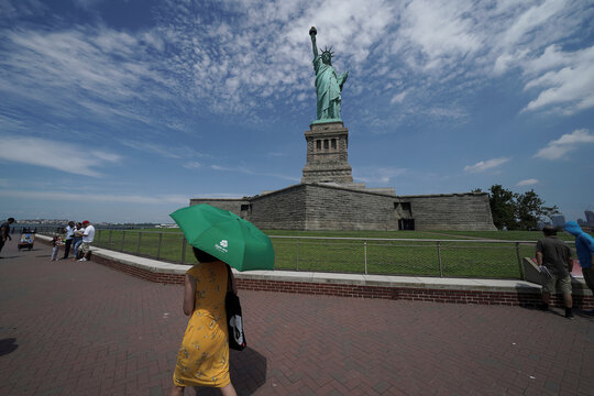 People are seen at the Statue of Liberty as New York enters Phase 4 of reopening following the outbreak of the coronavirus disease (COVID-19) in New York City