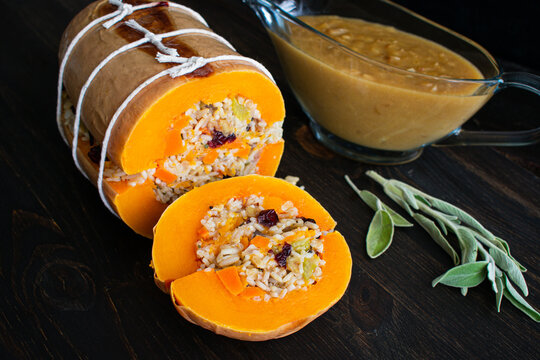 Stuffed Roasted Butternut Squash with Onion Gravy: Vegan Thanksgiving dish of roasted squash stuffed with rice and vegetables and served with onion gravy