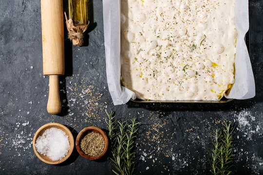 Raw focaccia dough in a baking dish
