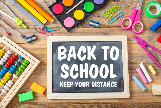 BACK TO SCHOOL KEEP YOUR DISTANCE  text on a blackboard. Coronavirus spread prevention measure