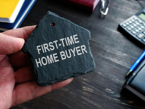 First time home buyer words on the stone house symbol.