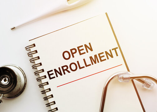 Open Enrollment - words written on notebook with stethoscope on white table, Medical Concept