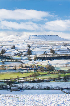 Fresh snow and winter sunshine covering the fell tops in Wensleydale around Nappa Scar and Addlebrough, North Yorkshire