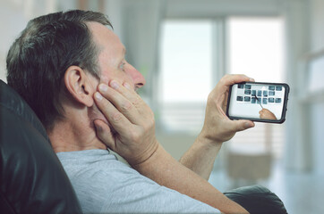 The man gets acquainted with the details of the upcoming dental treatment through a telemedicine application.