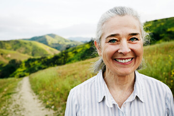 Caucasian woman standing on hiking trail