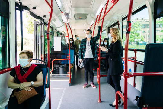 Passengers wearing protective masks in public bus, Spain