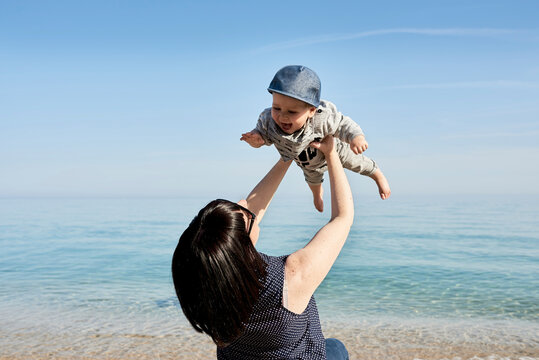 Mother playing with her son on beach