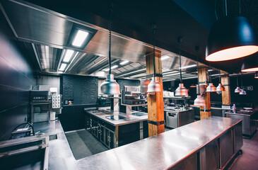 Interior of illuminated commercial kitchen in restaurant
