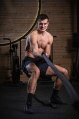 CrossFit athlete pulling rope