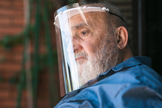 elderly man wearing a protective visor