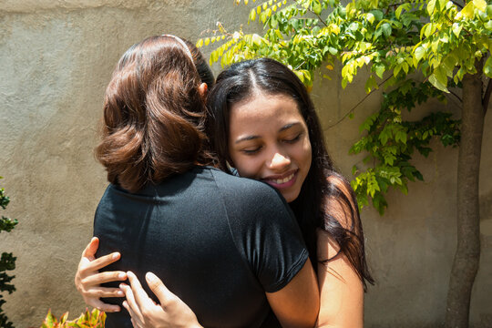 Daughter hugging mother for mother's day