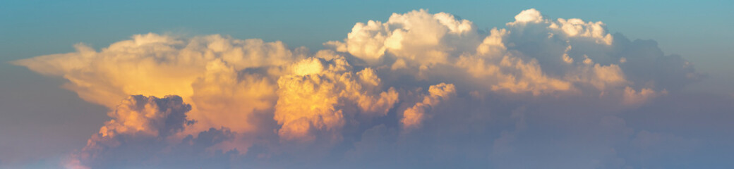 the formation of storm clouds illuminated by the setting sun-panorama