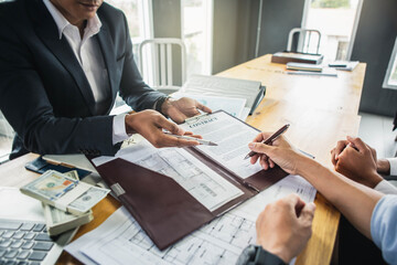 Customer signing contract documents for realty purchase, Bank employees congratulate, Concept mortgage loan approval. Business loan from a bank employee. finance concept .