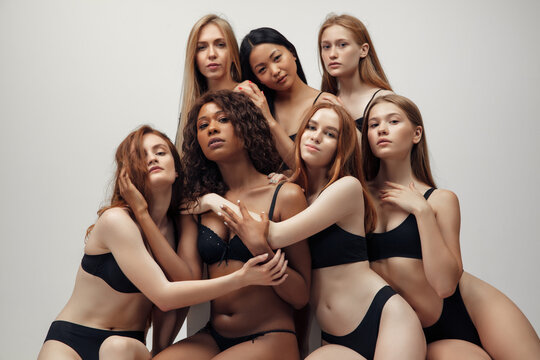 Group of women with different body and ethnicity posing together to show the woman power and strength. Curvy and skinny kind of female body concept. Beautiful girls, natural beauty, self-acceptance.