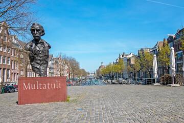 Amsterdam, Netherlands - April 7, 2020: Statue of Multatuli on a square in Amsterdam the Netherlands