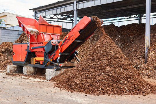 industrial woodchipper producing wood chips