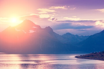 Fototapete - Fjord at sunset. Rocky seashore in the evening.  Beautiful nature of Norway. Picturesque Scandinavian landscape. Lofoten islands, Norway