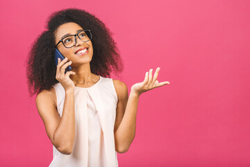 Portrait of a cute happy afro american black girl in casual talking on mobile phone and laughing...