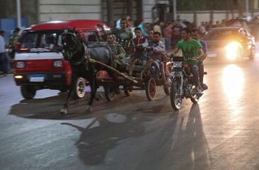 Egyptian merchants are seen in action during a horse cart race showing off their horses's strengths, following the outbreak of the coronavirus disease (COVID-19), in Cairo