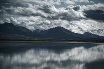 Mountains reflected in a lake. East Iceland landscape