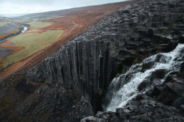 Studlafoss waterfall with basalt columns in East Iceland