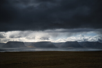 West Fjords or The Westfjords is region in north Iceland. Dramatic moody sky nature landscape