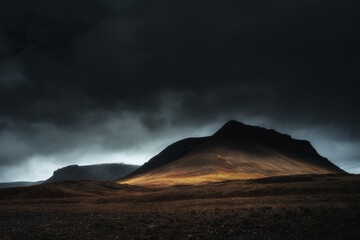 West Fjords or The Westfjords is region in north Iceland. Dramatic moody sky nature landscape. Color toned image