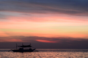 Fishing boat silhouette. Boracay island. Western Visayas. Philippines