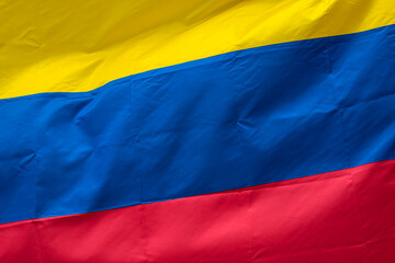 Photo sur Plexiglas Amérique du Sud Closeup to a Colombian flag waving with the wind. Nationality and country concept