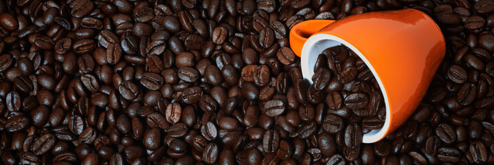 Wall Murals Cafe banner of coffee cup laying on coffee beans