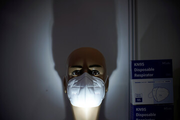 A face mask is seen at a mask stall at a procurement fair for epidemic-prevention materials in Shanghai