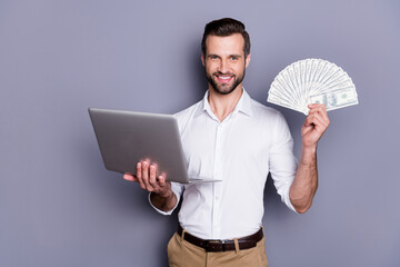 Photo Blinds Height scale Portrait of his he nice attractive rich successful cheerful brunet guy using laptop holding in hands investment playing online casino game bet isolated over gray pastel color background