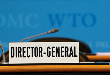 A sign is pictured in front of the chair of the Director General before the start of the General Council of the World Trade Organization (WTO) in Geneva
