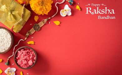 Wall Murals India Raksha Bandhan, Indian festival with beautiful Rakhi and Rice Grains on red background. A traditional Indian wrist band which is a symbol of love between Sisters and Brothers.