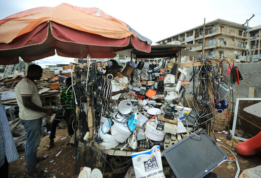 A man looks at electronic items for sale at a recycling centre in Abuja