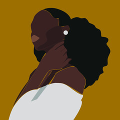 portrait of black woman in white blouse with white earrings on yellow background