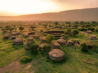 Obraz Aerial Drone Shot. Traditional Masai village at Sunset time near Arusha, Tanzania - fototapety do salonu