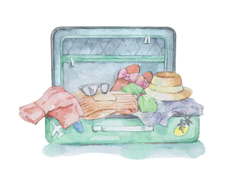 green suitcase filled with vacation stuff