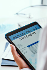 doctor checking a billing statement in his tablet