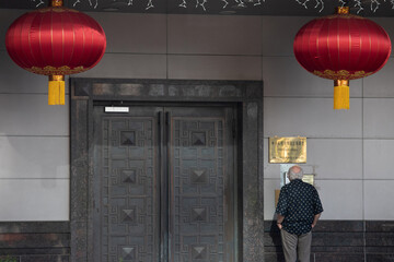 A man stands at the entrance of the China Consulate General in Houston, Texas